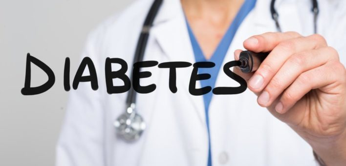 "Generic photo of a doctor writing ""Diabetes"""