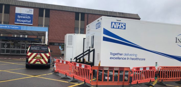 Photograph of 2 mobile treatment units outside the Trauma and Orthopaedic department of Ipswich Hospital