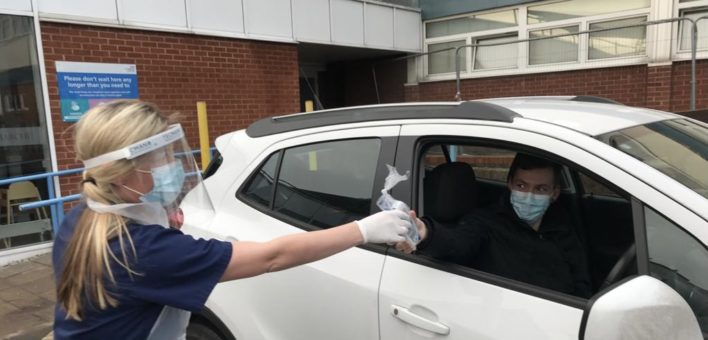 Cardiologist carrying out drive-through pacemaker check 2